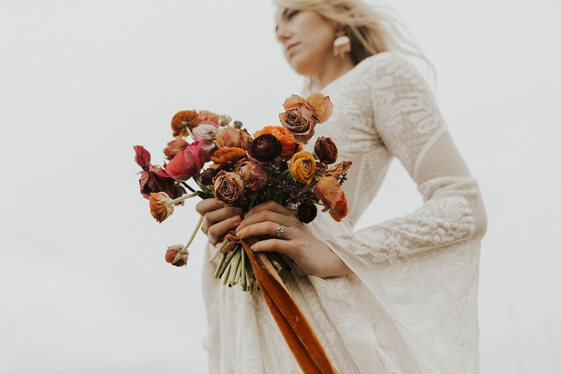 Dried bouquet with orange velvet ribbon