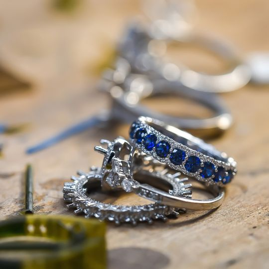 Diamond rings and a sapphire sidestone ring