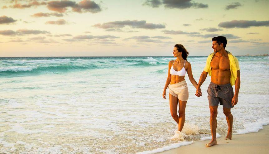 Honeymoon walk on the beach