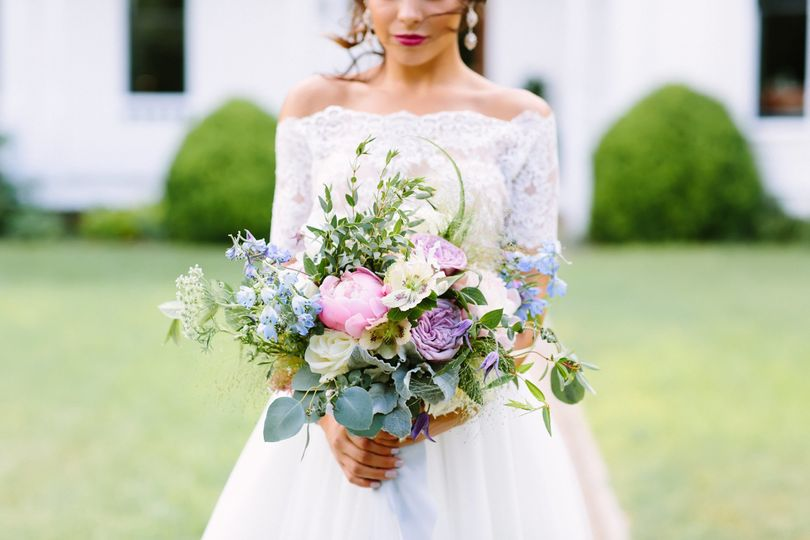 Off-shoulder wedding dress and bouquet