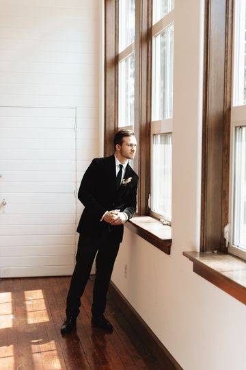 Groom looking out front window