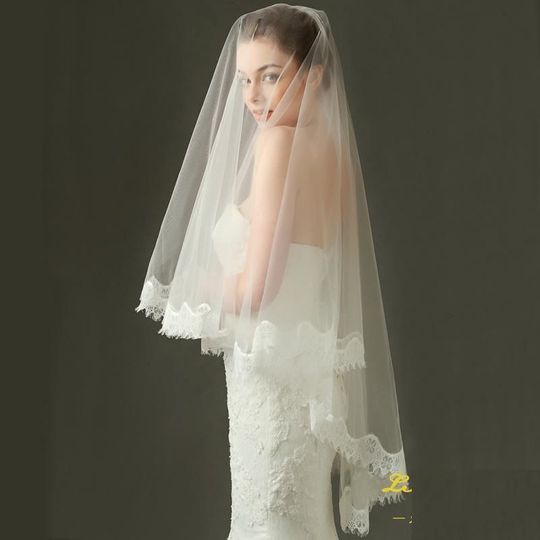 Fingertip length mantilla veil with scalloped lace