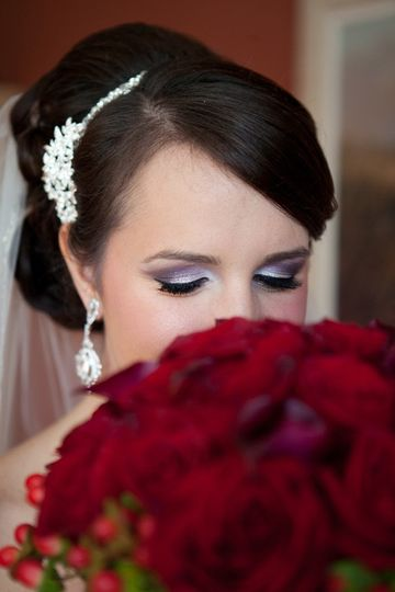 Bride holding red flowers