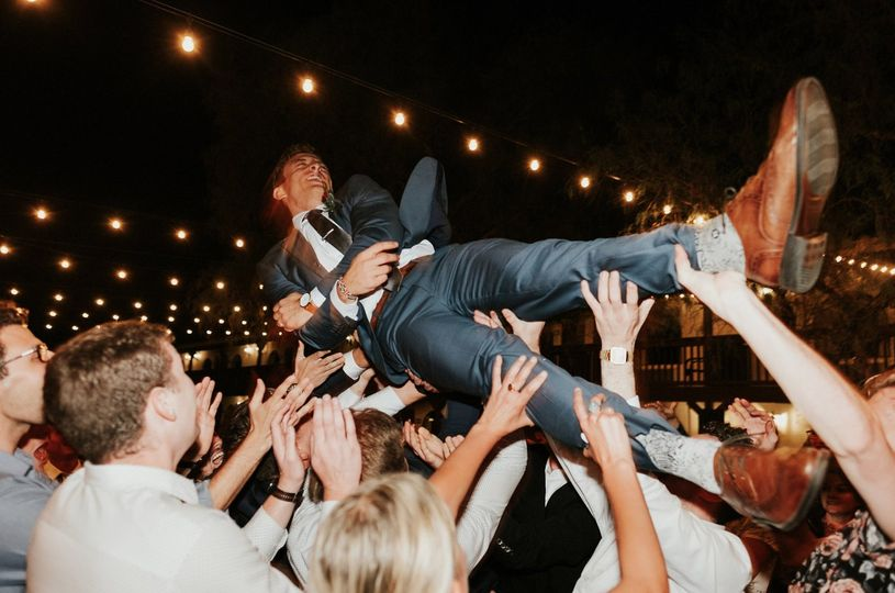 Crowd surfing grooms!