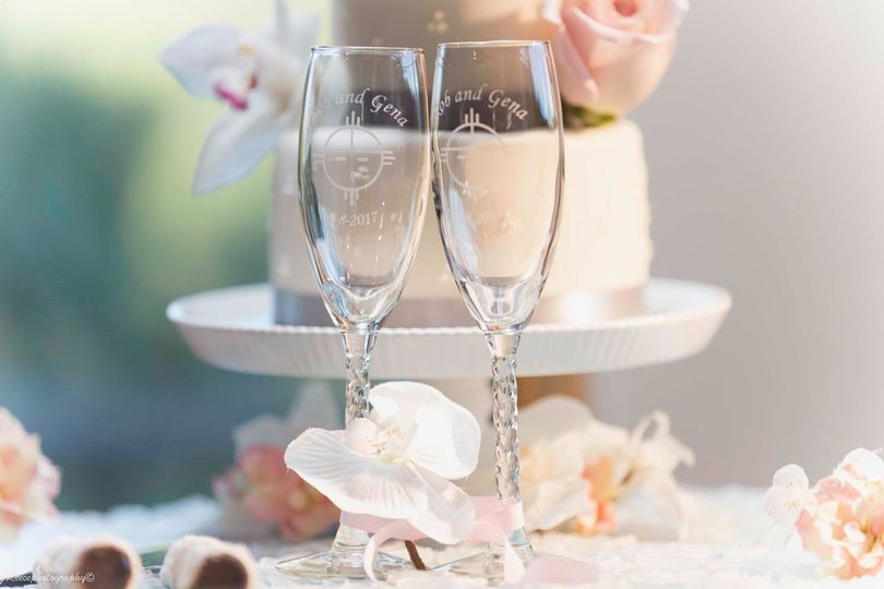 Luxury elopement packages include a small elopement cake and personalized champagne glasses.