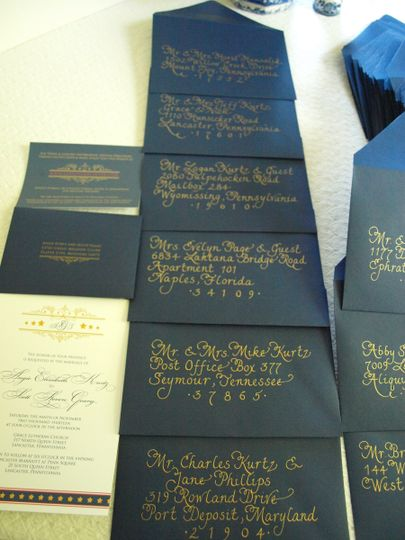 Veterans's Day themed wedding with gold ink on blue envelopes