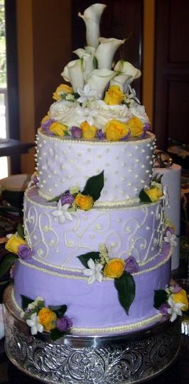 This is a 3 tiered cake with 3 seperate flavors.  The top tier is Pina Colata, middle tier,...