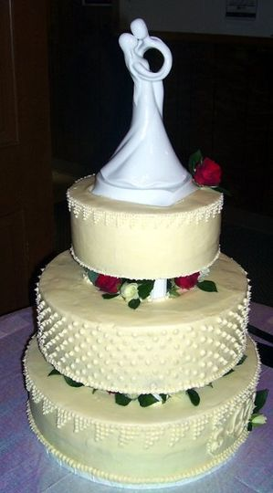 Simple cake with cream cheese icing over a white cake and red velvet cake