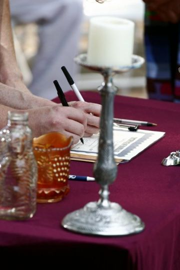 Signing the Wedding Certificate during the wedding ceremony provides a great photo opportunity,...