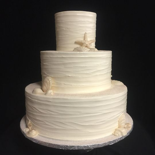 White wedding cake for beach wedding