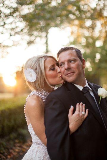 Bride kissing grooms cheek