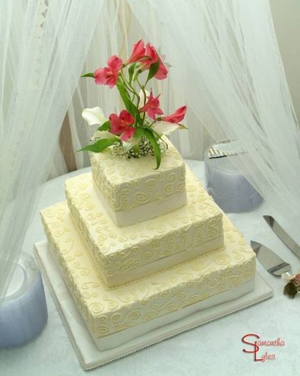 Three square double layers of cake create this elegant buttercream dream.  Chocolate, vanilla, and...