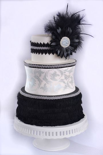 Black and white wedding cake with intricate detailing