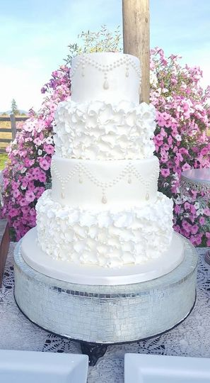 4-tier wedding cake with ruffled icing