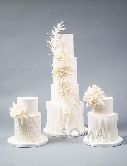 White dahlia wedding cake.