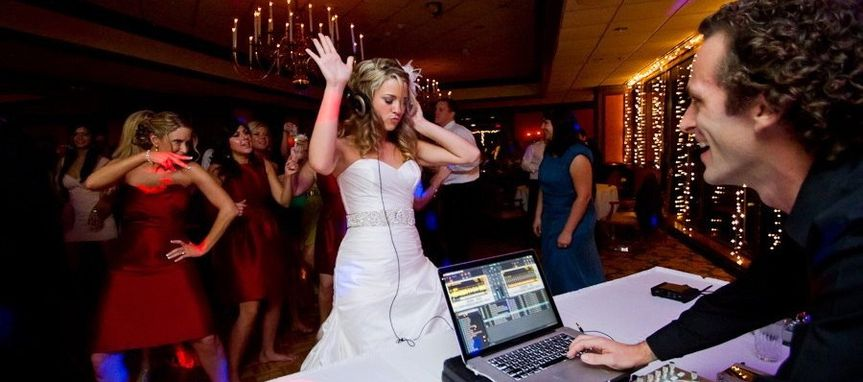 Bride jamming with the DJ
