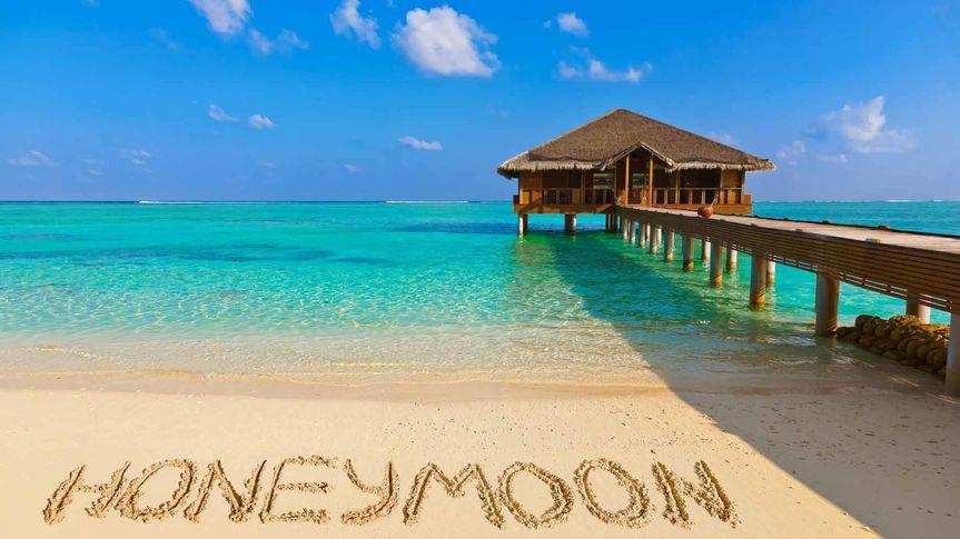 honeymoon beach sand overwater bungalow