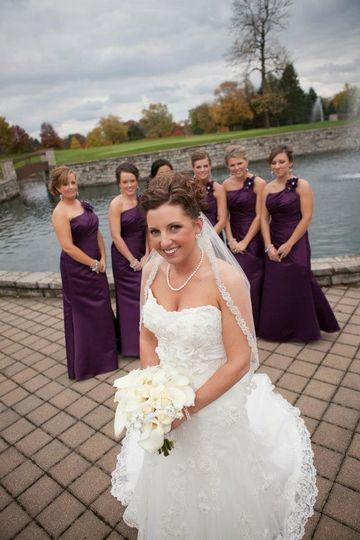 Bridesmaids behind the bride