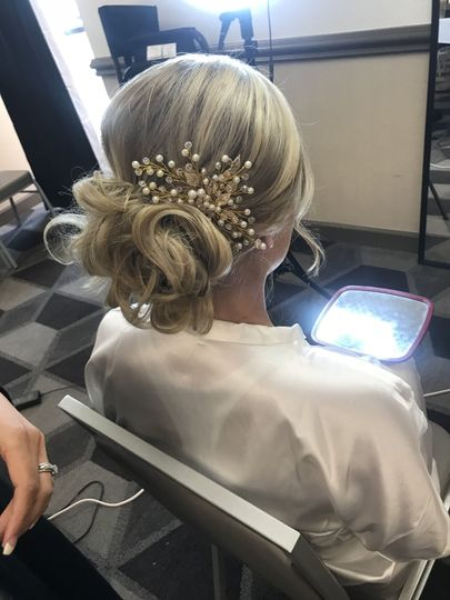 Messy low bun with baby's breath