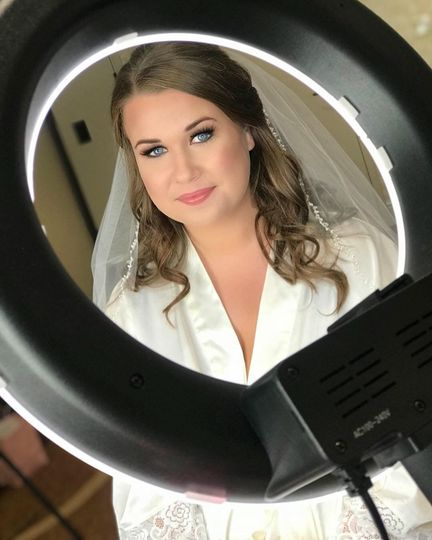Bride behind the ring light