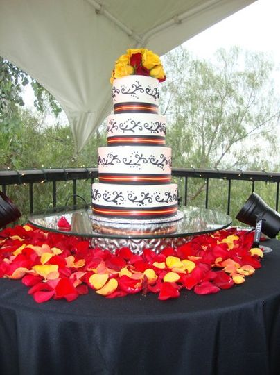 yellow, red, black and white wedding cake with scrolls