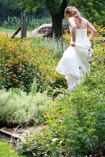 The beautiful bride takes a stroll through the gardens of the winery in State College, PA.