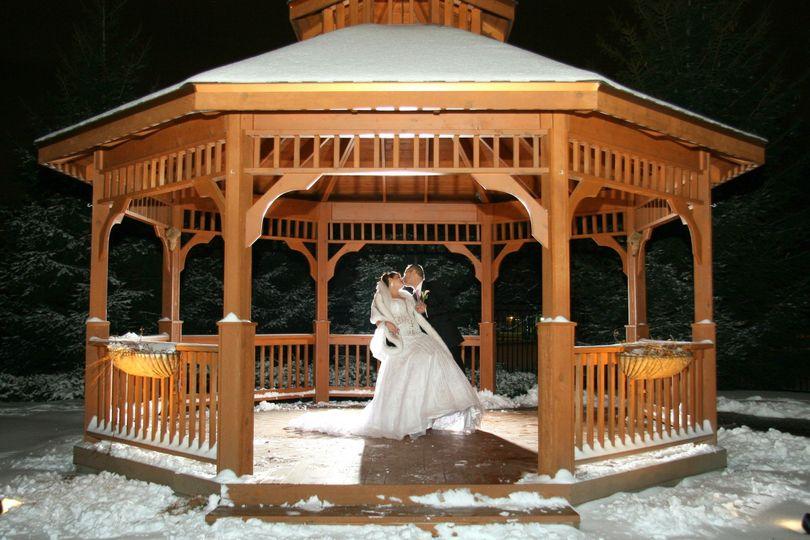 bride and groom gazebo winter love