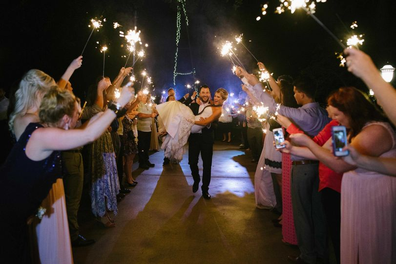 sparkler send off carrying bride