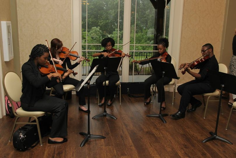 """String group playing at Teacher's banquet at """"Burritt on the Mountain""""."""