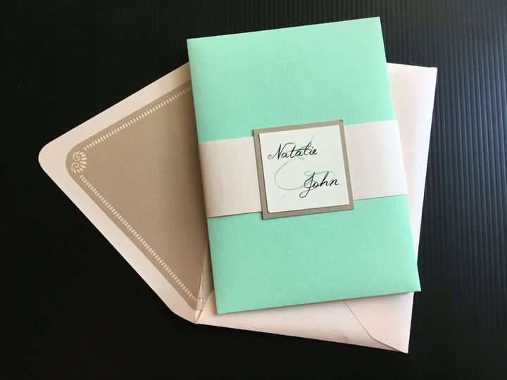 Invitation with bellyband, monogram, and envelope with laser cut liner