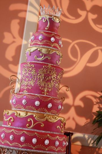 This 7 Tiered cake was painted in pinks and golds, with chocolate truffle and italian cream cakes...