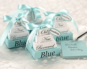 "A clever little favor with traditionally sweet style. Stacks of ""gift boxes"" in white and blue..."