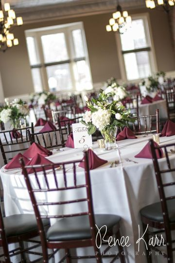 Maroon and white round table setup