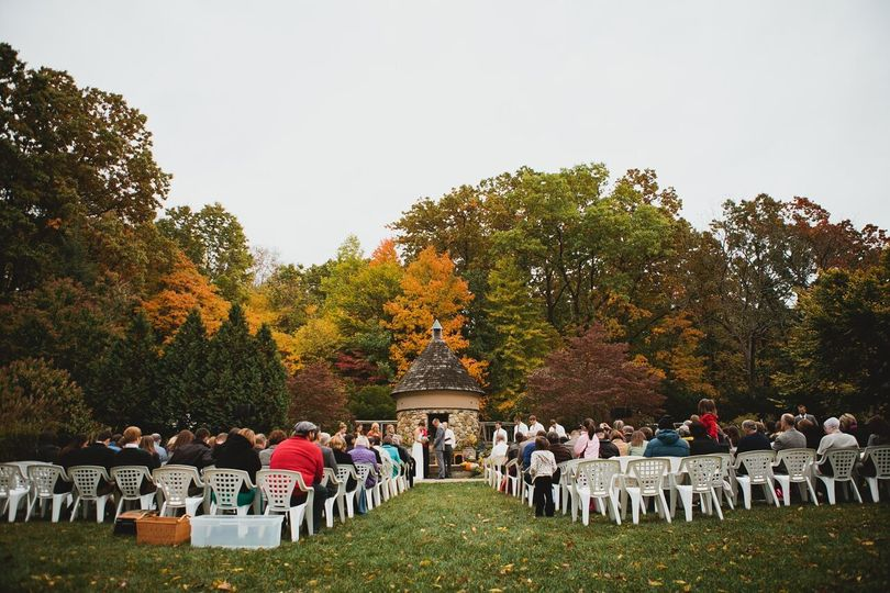 Fall Ceremony on The Green with Dovecote in background. Photo credit Ashley Dru Photography.