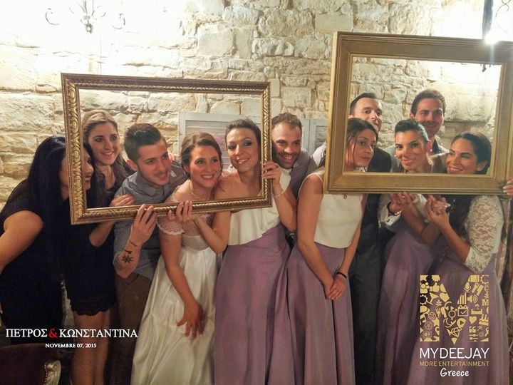 Newlyweds and their guests at the photo booth