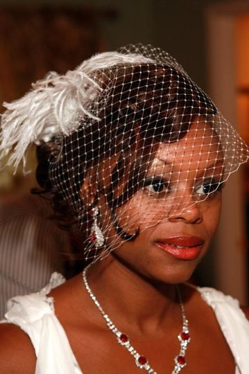 The bride wore a birdcage veil to complete her vintage look.