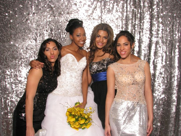 Stay fancy with ShutterBooth and this silver backdrop!