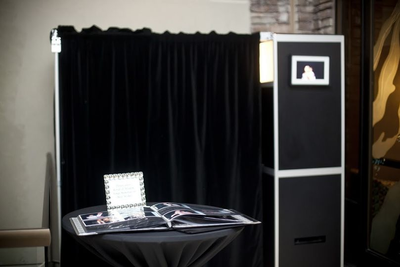 ShutterBooth enclosed with memory book with digital frame option.