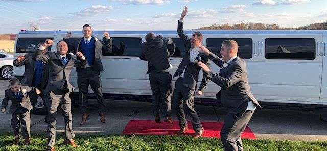 Groom and his groomsmen outside the stretch Hummer