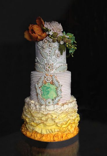 Yellow frills white pearls blue and gold wedding cake