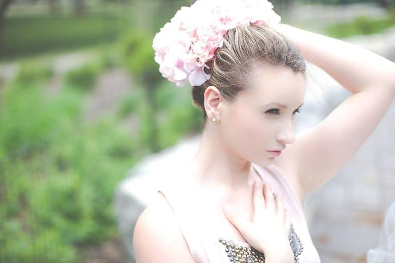 Bridal updo and floral headpiece