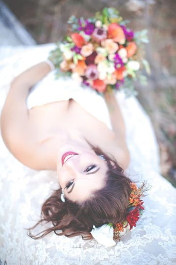 Bride lying down with her bouquet