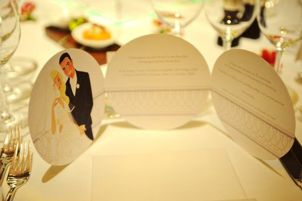 wedding stationery with bespoke illustration, showing the couple in a stylized similarity. Here...