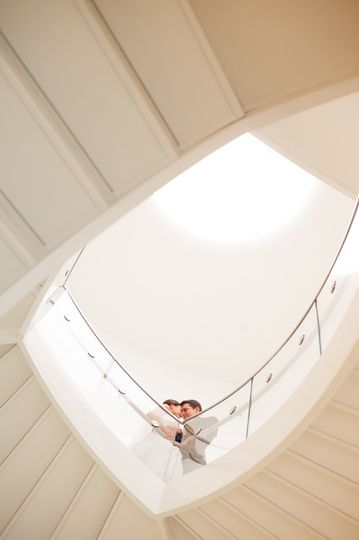 bride and groom on overture center stairs