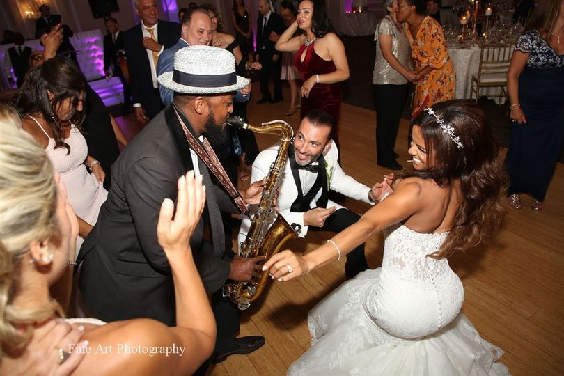 Bride and groom with sax