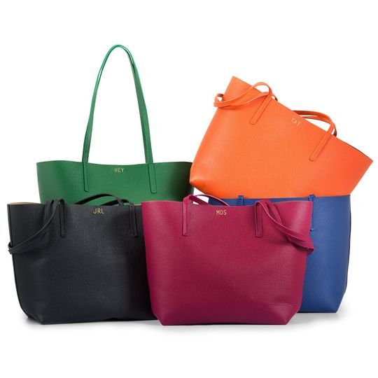 The perfect maid-of-honor gift: A colorful leather tote bag, personalized with her metallic initials