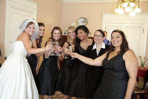 Reverend Jennifer Tan toasting with the bridal party before the ceremony at Vizcaya, Sacramento....