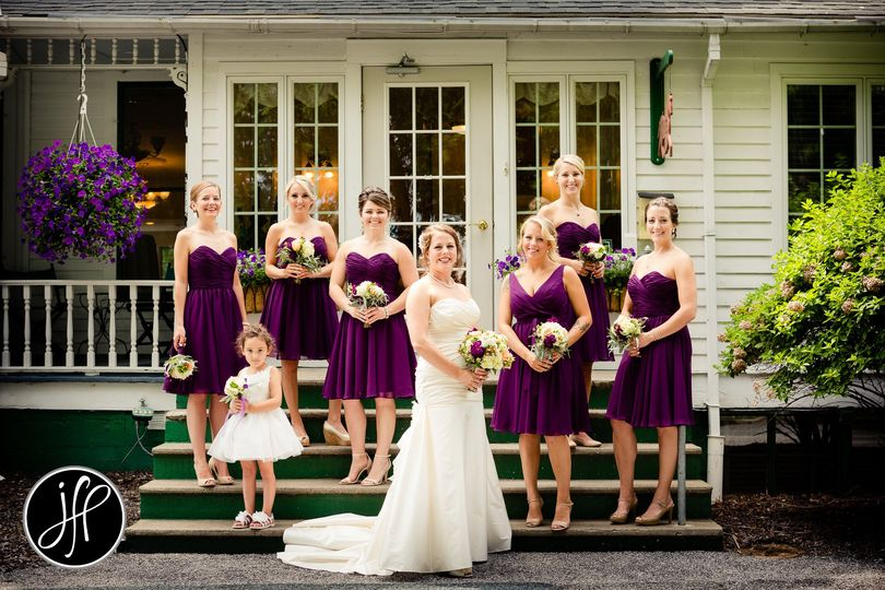 Bride with flower girl and bridesmaids