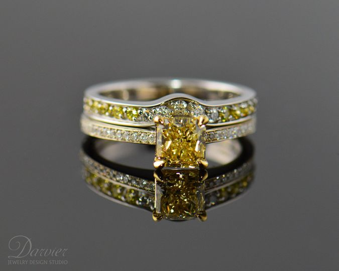 Bold yellow diamond radiant cut with faded yellow accent diamonds - keeping it just different...