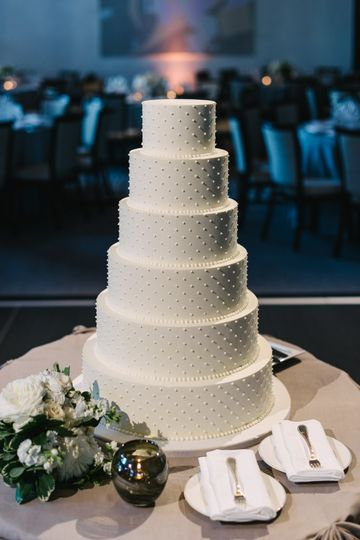 5 tier classic buttercream wedding cake with piped buttercream dots